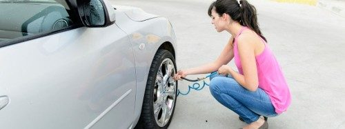 woman filling up her car with air